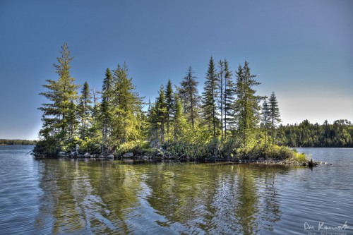 island with evergreen trees in northern ontario