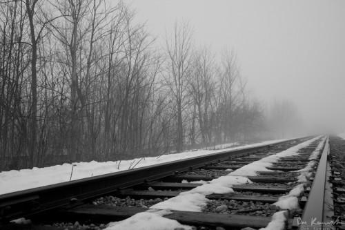 train tracks in the winter fog