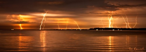 Multiple lightning bolts across water
